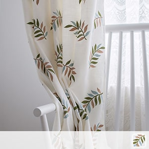 drape curtains with elaborate leaf embroidery