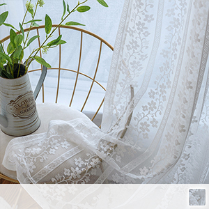 sheer curtains with floral design in silhouette