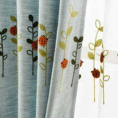 Curtains embroidered with pop and cute ladybirds