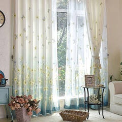 A curtain with beautiful butterflies dancing in the flowers