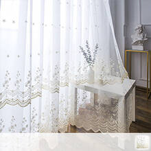 Gorgeous Sheer Curtains with scalloped hem beautifully decorating the windowsill